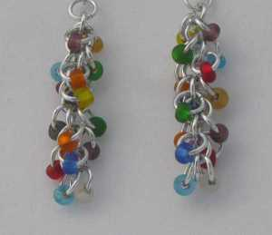 Anodized aluminum rings and glass beads colors: bright silver and multi-colored beads weave: shaggy loops size: 1  3/4