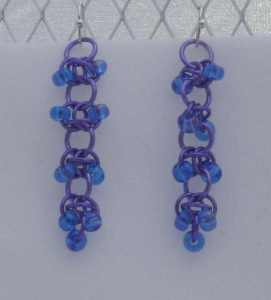 Anodized aluminum rings and glass beads colors: purple and blue beads weave: rsd size: 1  5/8