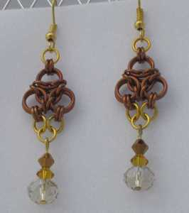Anodized aluminum rings and crystal beads colors: bronze and gold weave: aura size: