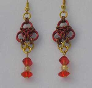 Anodized aluminum rings and beads colors: red, bronze, and gold weave: aura size: