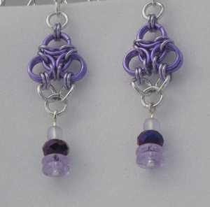 Anodized aluminum rings with beads colors: purple, lavender, and bright silver weave: aura size: