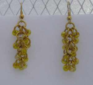 Anodized aluminum rings with beads colors:  gold weave: shaggy loops size: 1  1/4