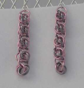 Anodized aluminum rings colors: pink and black ice weave: beestings size: 1  3/4