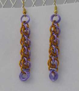 Anodized aluminum rings colors: purple and orange weave: bee stings size: 2