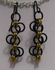 Anodized aluminum rings colors: black and gold weave: Lorenz's Forget-me-not  size: 1 3/8