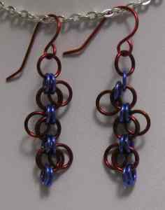 Anodized aluminum rings  colors: Purple and red  weave: Lorenz's forget-me-not size: 1 3/8