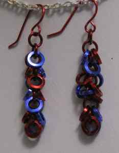 Anodized aluminum rings  colors: Purple and red  weave: Shaggy loops  size: 1 1/2